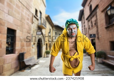Strange man with face pack in the street - stock photo