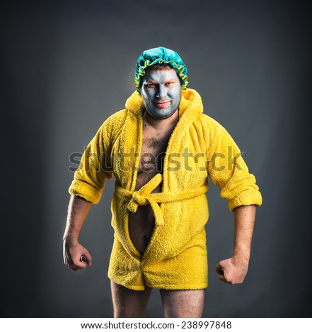 Strange man with face pack on grey - stock photo