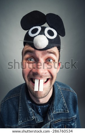 Strange man with mouse ears - stock photo