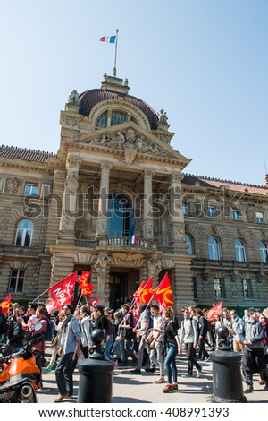 STRASBOURG, FRANCE - APR 20, 2016: Place de la republique with Palais du Rihn in the background and hundreds of people demonstrate as part of nationwide day of protest