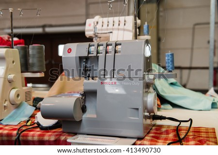 STRASBOURG, FRANCE - APR 24, 2016: Singer sewing machines at traditional textile covered market with multiple different colors and textures