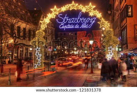 STRASBOURG, FRANCE, DEC 12: People walking on the street during the festive Christmas illumination on December 12 2012 in Strasbourg. In winter here is held a famous Christmas market and illumination.