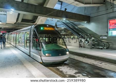 STRASBOURG, FRANCE - DECEMBER 21, 2014: Modern tram on station Gare de Strasbourg (main railway station). - stock photo
