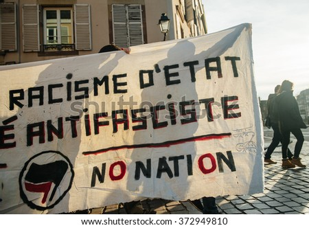 STRASBOURG, FRANCE - FEB 6, 2016: Protesters marching with no border no nation placard during a demonstration against government's plan to extent the 'state of emergency' and for opened borders