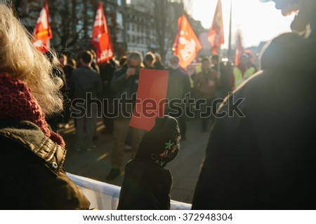 STRASBOURG, FRANCE - FEB 6, 2016: Protesters showing red carton for the government during a demonstration against government's plan to extent the 'state of emergency' and for opened borders -