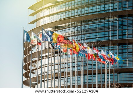 STRASBOURG, FRANCE - JAN 28, 2016: Impressive European Parliament building in Strasbourg, France with flags waving on a spring evening