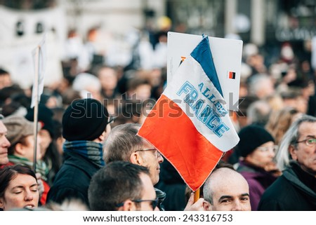 STRASBOURG, FRANCE - 11 JAN, 2015:  People hold placards reading 'Go France during a unity rally (Marche Republicaine) where some 50000 took part in tribute three-day killing spree in Paris