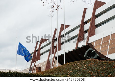 STRASBOURG, FRANCE - 8 JAN 2015, The European Union Flag flies at half-mast in front of the Council of Europe following an attack against French satirical weekly newspaper Charlie Hebdo - stock photo