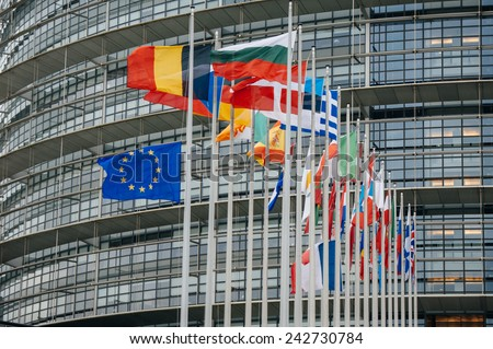 STRASBOURG, FRANCE - JAN 8, 2015: The French and European Union Flag flies at half-mast in front of the European Parliament following an attack the day before against weekly newspaper Charlie Hebdo - stock photo