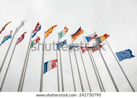 STRASBOURG, FRANCE - JAN 8, 2015: The French and European Union Flag flies at half-mast in front of the European Parliament following an attack the day before against weekly newspaper Charlie Hebdo