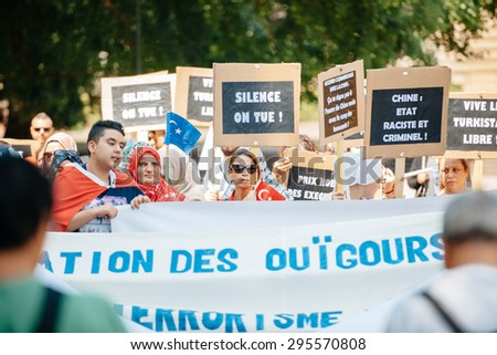 STRASBOURG, FRANCE - JULY 11, 2015: Uyghur human rights activists participate in a demonstration to protest against Chinese government's policy in Uyghur - stock photo