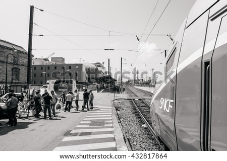STRASBOURG, FRANCE - JUN 6, 2016: Protesters making barbeque outside Gare de Strasbourg, during demonstration by railway workers of state rail SNCF as part of a strike to defend their work conditions - stock photo