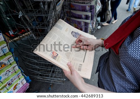 STRASBOURG, FRANCE - JUN 25, 2016: Woman buying Financial Times newspaper pointing to Pond exchange rate after the Brexit referendum in United Kingdom requesting to quit the European Union