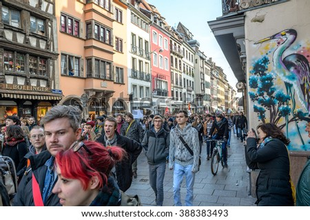 STRASBOURG, FRANCE - 9 MAR 2016: Crowd marching on the Rue du Vieux Marche aux Poissons as part of nationwide day of protest against proposed labor reforms by Socialist Government