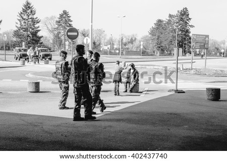 STRASBOURG, FRANCE - MAR 20, 2016: Four vigipirate soliders inspecting the Entzheim Aeroport area for possible terrorists and for the security of the passengers - stock photo