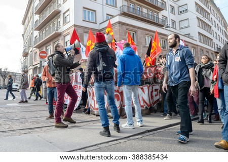 STRASBOURG, FRANCE - 9 MAR 2016: People blocking street as thousands of people demonstrate as part of nationwide day of protest against proposed labor reforms by Socialist Government