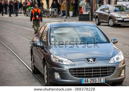 STRASBOURG, FRANCE - 9 MAR 2016: Police special forces car driving in front of demonstrating people as part of nationwide day of protest against proposed labor reforms by Socialist Government