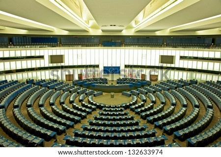 STRASBOURG, FRANCE - 20 MARCH 2013: Plenary room of the European Parliament in Strasbourg, France on 20 March 2013.  All votes of the European Parliament must take place in Strasbourg, France. - stock photo