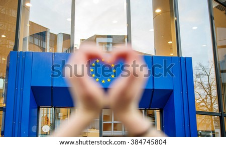 STRASBOURG, FRANCE - MARCH 24, 2015: Woman hands in shape of love heart with the stars of European Union in the hearts shape - stock photo