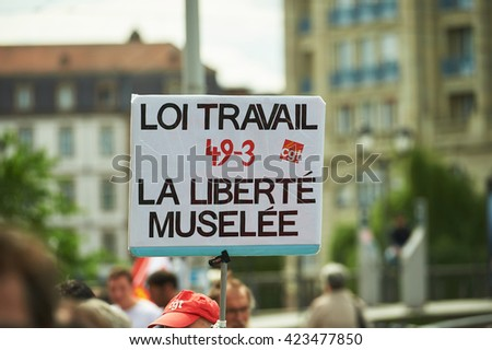 STRASBOURG, FRANCE - MAY 19, 2016: Anti-labor placard during a demonstrations against proposed French government's labor and employment law reform - stock photo