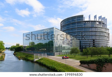 """STRASBOURG, FRANCE - MAY 30: Building """"Louise Weiss"""" of European Parliament on May 30, 2014 in Strasbourg, France. The building houses the Chamber of Parliament and Members' offices.  - stock photo"""