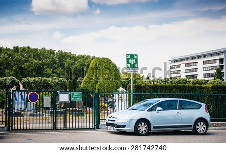 STRASBOURG, FRANCE - MAY 23, 2015: French car parked in front of Meeting Point sing at the entrance to Neudorf cemetery - Cimetiere Municipal Saint Urbain - in Strasbourg, France  - stock photo
