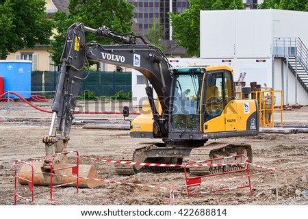 STRASBOURG, FRANCE - MAY 15, 2016: Front view of VOLVO excavator in construction area - stock photo