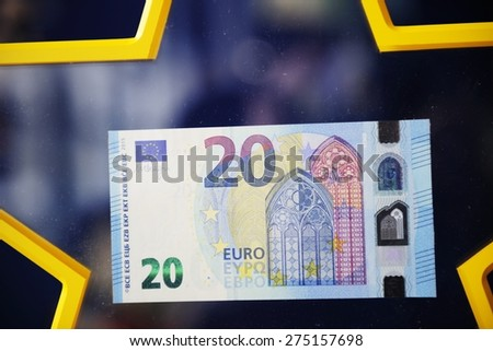 STRASBOURG, FRANCE - MAY 2, 2015: New 20 Euro banknote with the European symbol Europe is highly protected and has a new design and will start circulating in the euro area on 25 November 2015. - stock photo