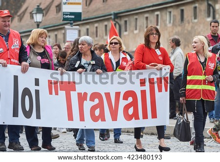 STRASBOURG, FRANCE - MAY 19, 2016: People marching on closed central streets in Strasbourg with retire labor reform placard during a demonstration against proposed French government's law reform