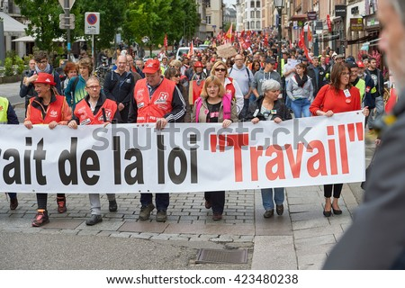 STRASBOURG, FRANCE - MAY 19, 2016: People marching on closed central streets in Strasbourg with retire labor reform placard during a demonstration against proposed French government's reform - stock photo
