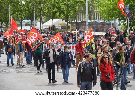 STRASBOURG, FRANCE - MAY 19, 2016: People walking with placards during a demonstrations against proposed French government's labor and employment law reform