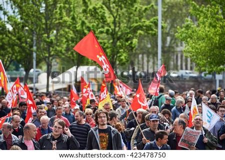 STRASBOURG, FRANCE - MAY 19, 2016: People walking with placards during a demonstrations against proposed French government's labor and employment law reform - stock photo