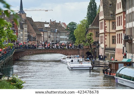 STRASBOURG, FRANCE - MAY 19, 2016: Protestors over Pont du Corbeau during a demonstrations against proposed French government's labor and employment law reform - stock photo