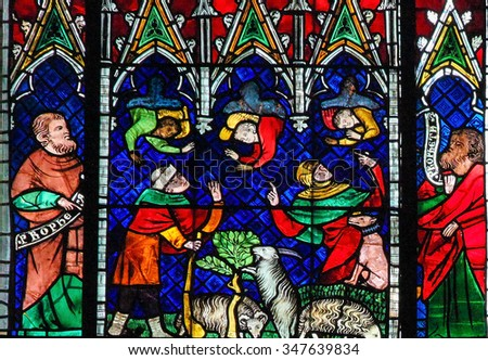 STRASBOURG, FRANCE - MAY 9, 2015: Stained glass depicting Angels and Goats in the cathedral of Strasbourg, France - stock photo