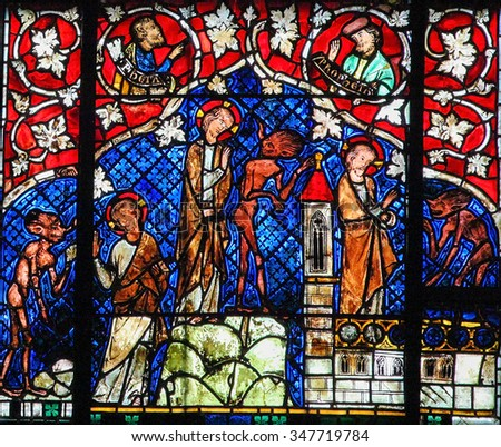 STRASBOURG, FRANCE - MAY 9, 2015: Stained glass depicting The Temptation of Christ by the Devil in the cathedral of Strasbourg, France - stock photo