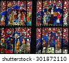 STRASBOURG, FRANCE - MAY 9, 2015: Stained glass depicting various scenes in the Life of Jesus, including the Baptism by Saint John and the temptation by Satan, in the cathedral of Strasbourg, France - stock photo