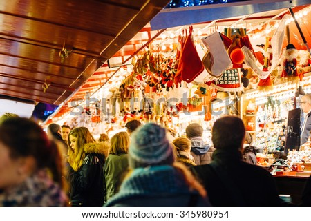 STRASBOURG, FRANCE - NOV 28, 2015: Busy Christmas Market Christkindlmarkt in the city of Strasbourg, Alsace region,  France with people admiring Christmas gifts - stock photo