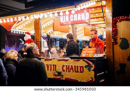 STRASBOURG, FRANCE - NOV 28, 2015: Busy Christmas Market Christkindlmarkt in the city of Strasbourg, Alsace region,  France with people buying mulled wine  - stock photo