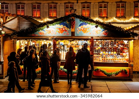 STRASBOURG, FRANCE - NOV 28, 2015: Busy Christmas Market Christkindlmarkt in the city of Strasbourg, Alsace region,  France with people admiring gifts at kiosk