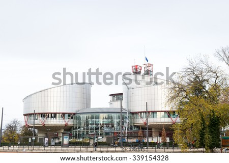 STRASBOURG, FRANCE - 14 Nov 2015: European Union Flag flies at half-mast in front of the European Court of human Rights following an terrorist attack in Paris - stock photo