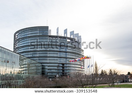 STRASBOURG, FRANCE - 14 Nov 2015: European Union Flags and France flag flies at half-mast in front of the European Parliament building following an terrorist attack in Paris - stock photo