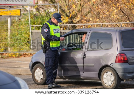 STRASBOURG, FRANCE - NOV 14 2015: French Police checking vehicles on the 'Bridge of Europe' between Strasbourg and Kehl Germany, as a measure after attacks in Paris - security passport check - stock photo