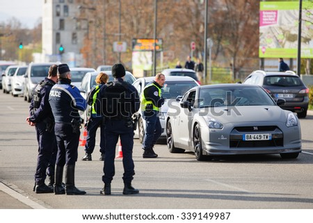 STRASBOURG, FRANCE - NOV 14 2015: French Police checking vehicles on the 'Bridge of Europe' between Strasbourg and Kehl Germany, as a measure in the wake of attacks in Paris - officer inspecting car