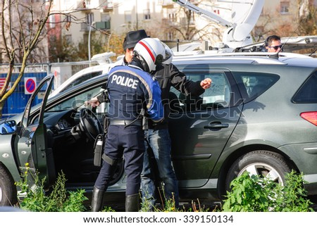 STRASBOURG, FRANCE - NOV 14 2015: French Police checking vehicles on the 'Bridge of Europe' between Strasbourg and Kehl Germany, as after attacks in Paris officer body searching drivers, surveillance - stock photo
