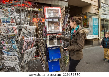 STRASBOURG, FRANCE - 14 NOV, 2015: The front covers of International newspapers display headlining the terrorist attacks yesterday in Paris - stock photo