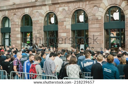 STRASBOURG, FRANCE - SEPTEMBER 19, 2014: Customers wait in line outside the Apple Inc. store during the sales launch of the iPhone 6 and iPhone 6 Plus in Europe, on Friday, Sept. 19, 2014