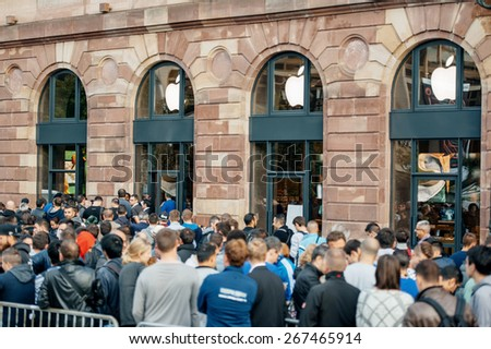 STRASBOURG, FRANCE - SEPTEMBER 19, 2014: Customers wait in line outside the Apple Inc. store during the sales launch of the iPhone 6 and iPhone 6 Plus in Europe, on Friday, Sept. 19, 2014.