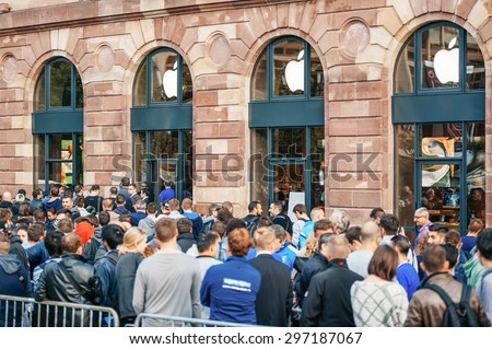 STRASBOURG, FRANCE - SEPTEMBER 19, 2014: Customers wait in line outside the Apple Inc. store during the sales launch of the iPhone 6 and iPhone 6 Plus in Europe