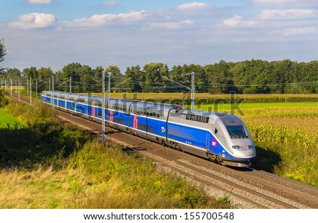 STRASBOURG, FRANCE - SEPTEMBER 22: SNCF TGV Euroduplex train on a way to Paris on September 22, 2013 in Strasbourg, France. Complete hi-speed railway between Strasbourg and Paris to be opened in 2016 - stock photo