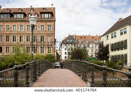 STRASBOURG, FRANCE - SEPTEMBER 09, 2010: Strasbourg's cityscape with a foot-bridge over the Ill river. Strasbourg is the capital and principal city of the Alsace region in north eastern France.